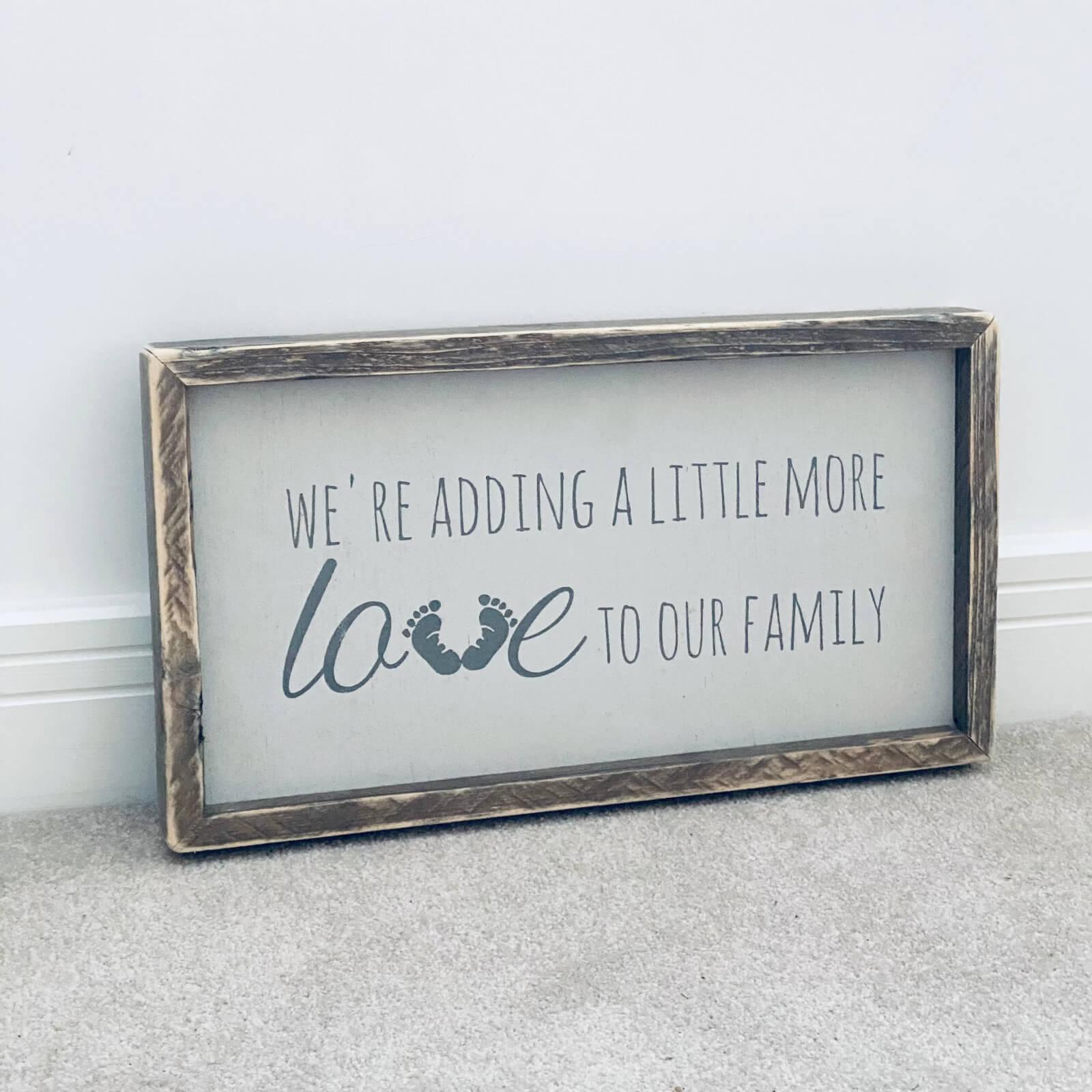 We're adding a little more love – Pregnancy Announcement – Framed Wooden Sign Kind Shop