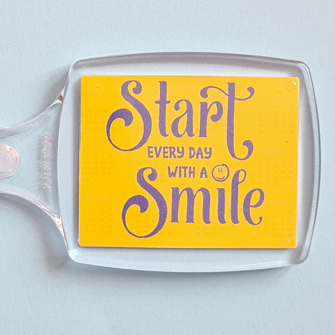 Keyring: Start every day with a smile. Fundraising keyring. Kind Shop
