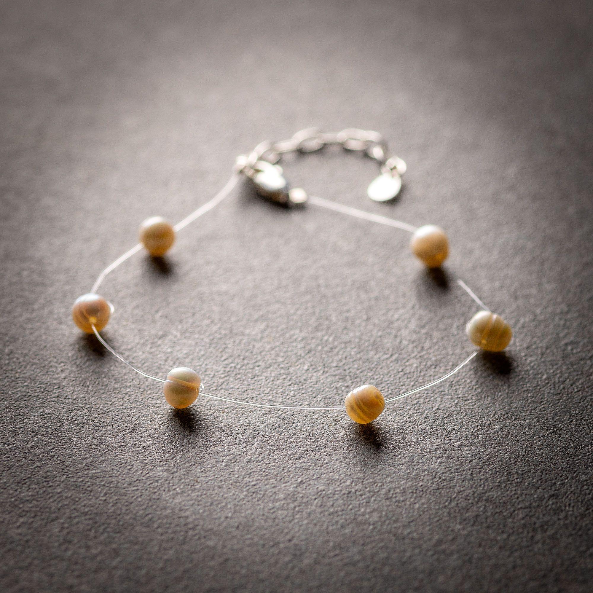 White pearls floating bracelet