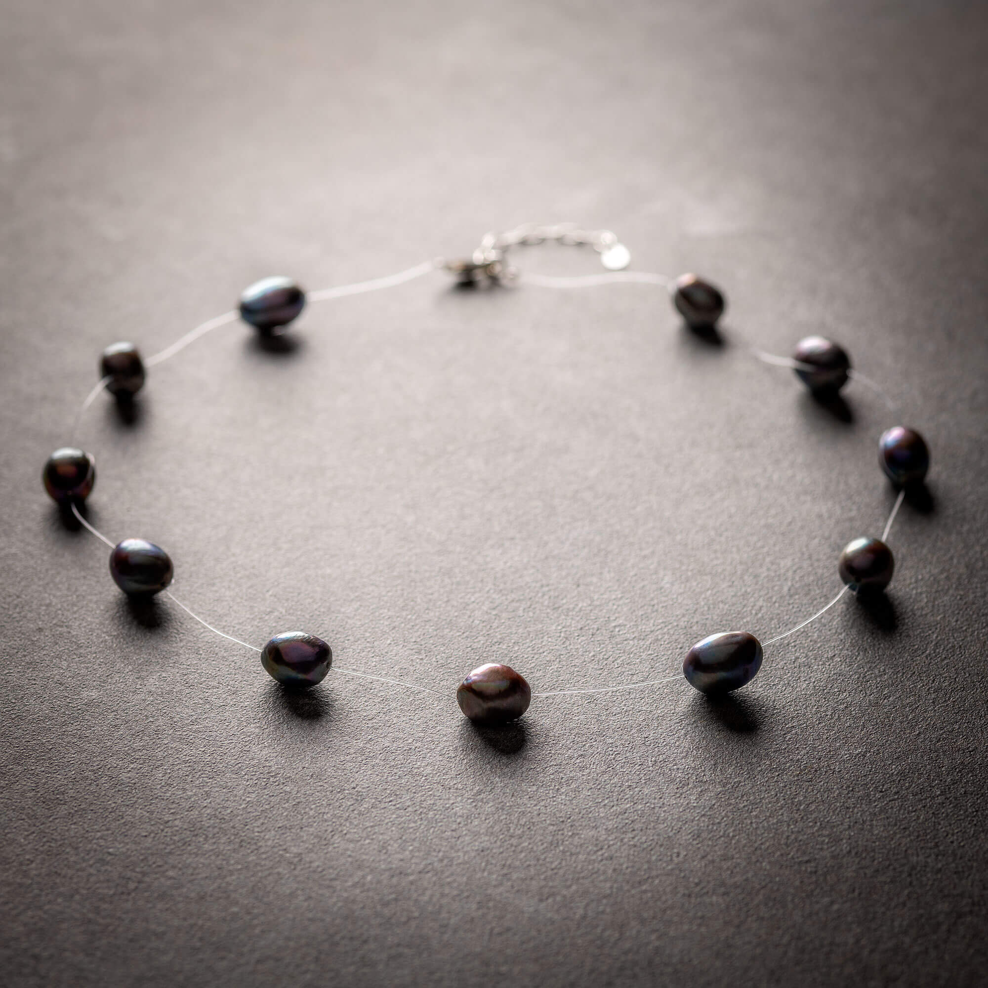 Large black floating pearl necklace